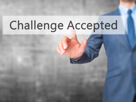 Challenge Accepted - Businessman hand pressing button on touch screen interface. Business, technology, internet concept. Stock Photo