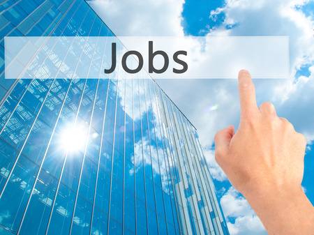 Photo pour Jobs - Hand pressing a button on blurred background concept . Business, technology, internet concept. Stock Photo - image libre de droit