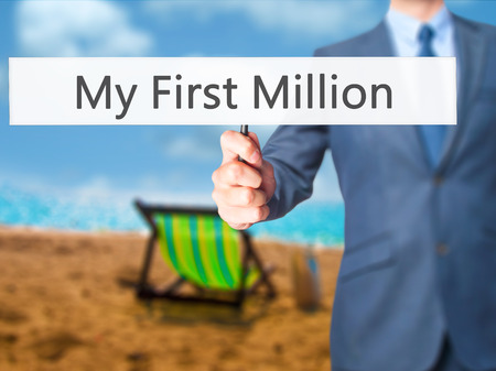 My First Million - Businessman hand holding sign. Business, technology, internet concept. Stock Photo