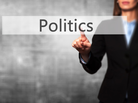 Politics - Isolated female hand touching or pointing to button. Business and future technology concept. Stock Photo