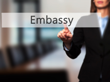 Embassy - Businesswoman pressing modern  buttons on a virtual screen. Concept of technology and  internet. Stock Photo