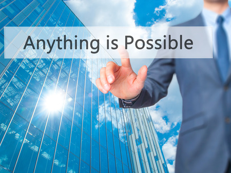 Anything is Possible - Businessman click on virtual touchscreen. Business and IT concept. Stock Photo