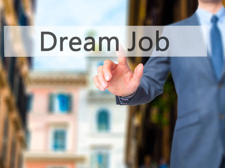 Dream Job - Businessman hand pressing button on touch screen interface. Business, technology, internet concept. Stock Photo
