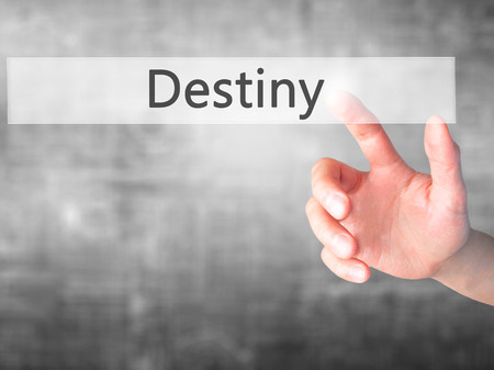 Destiny - Hand pressing a button on blurred background concept . Business, technology, internet concept. Stock Photo