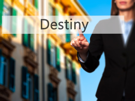 Destiny - Isolated female hand touching or pointing to button. Business and future technology concept. Stock Photo