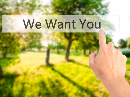 We Want You - Hand pressing a button on blurred background concept . Business, technology, internet concept. Stock Photo
