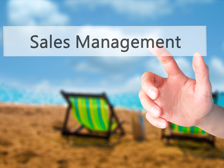 Sales Management - Hand pressing a button on blurred background concept . Business, technology, internet concept. Stock Photo