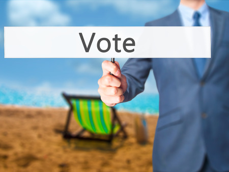 Vote - Businessman hand holding sign. Business, technology, internet concept. Stock Photo