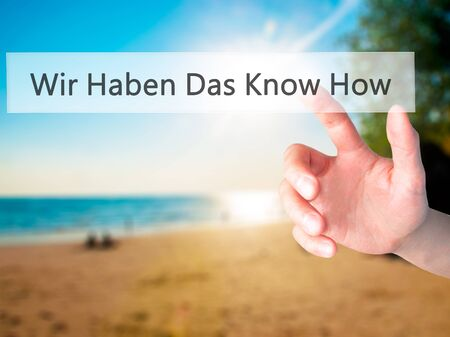 Wir Haben Das Know How! (We Have the Know-How in German) - Hand pressing a button on blurred background concept . Business, technology, internet concept. Stock Photo