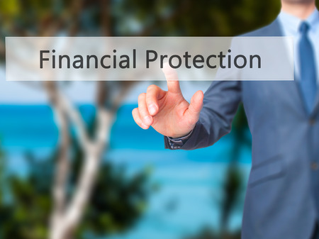Financial Protection - Businessman hand touch  button on virtual  screen interface. Business, technology concept. Stock Photo