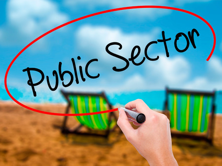 Man Hand writing Public Setor with black marker on visual screen. Isolated on sunbed on the beach. Business, technology, internet concept. Stock Photo