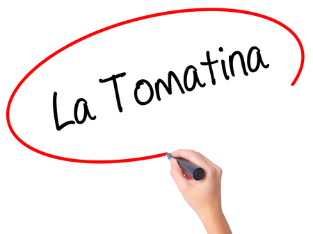 Women Hand writing La Tomatina with black marker on visual screen. Isolated on white. Business, technology, internet concept.