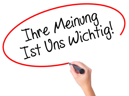 Photo for Women Hand writing Ihre Meinung Ist Uns Wichtig! (Your Opinion is Important to Us in German) with marker on visual screen. Isolated on white. Business, technology, internet concept. Stock Photo - Royalty Free Image