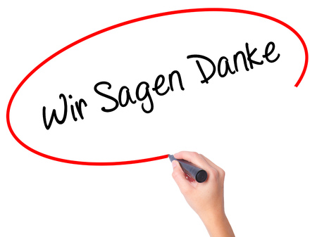 Foto für Women Hand writing Wir Sagen Danke (We Say Thank You In German)   with black marker on visual screen. Isolated on white. Business, technology, internet concept. Stock Photo - Lizenzfreies Bild