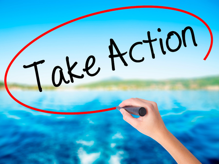 Photo pour Woman Hand Writing Take Action on blank transparent board with a marker isolated over water background. Business concept. Stock Photo - image libre de droit