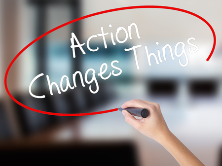 Woman Hand Writing Action Changes Things with a marker over transparent board. Isolated on Office. Business concept. Stock Photo