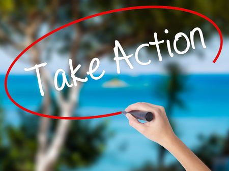 Photo pour Woman Hand Writing Take Action with black marker on visual screen. Isolated on nature. Business concept. Stock Photo - image libre de droit