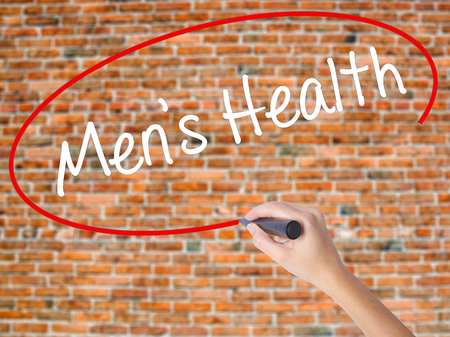 Foto de Woman Hand Writing Men's Health with black marker on visual screen. Isolated on bricks. Business concept. Stock Photo - Imagen libre de derechos