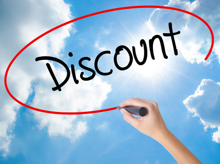 Woman Hand Writing Discount with black marker on visual screen. Isolated on Sunny Sky. Business concept. Stock Photo