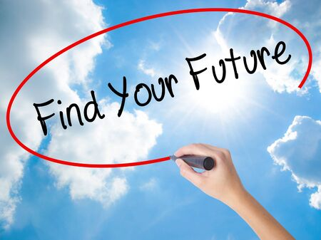 Woman Hand Writing Find Your Future with black marker on visual screen. Isolated on Sunny Sky. Business concept. Stock Photo