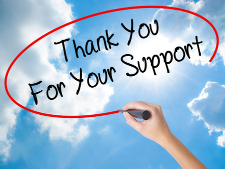 Woman Hand Writing Thank you For Your Support  with black marker on visual screen. Isolated on Sunny Sky. Business concept. Stock Photo