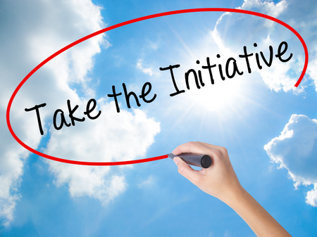 Photo pour Woman Hand Writing Take the Initiative with black marker on visual screen. Isolated on Sunny Sky. Business concept. Stock Photo - image libre de droit