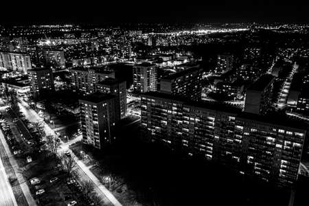 Photo for View from above of the roofs of contemporary block of flats. Ulyanovsk residential district at nigh. Black and white - Royalty Free Image