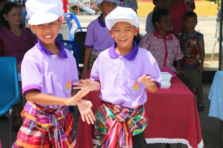 MUANG, MAHASARAKHAM - OCTOBER 5 : Unidentified children are proceeding gracefully papaya salad cooking with Thai dance contest in healthy way of life festival on October 5, 2012 at sport ground, Kerng local administration institute, Muang, Mahasarakham, T