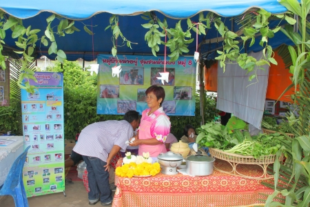 MUANG, MAHASARAKHAM - OCTOBER 5 : Unidentified villagers are decorating shop and preparing food cooking contest in healthy way of life festival on October 5, 2012 at sport ground, Kerng local administration institute, Muang, Mahasarakham, Thailand.