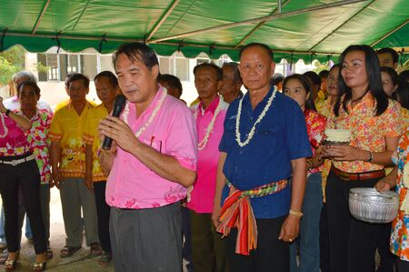 MUANG, MAHASARAKHAM - APRIL 11 : Unidentified people are asking Distric Director and his wife for blessing in Thai New Year or Songkran Festival on April 11, 2013 at District Director House, Muang, Mahasarakham, Thailand.