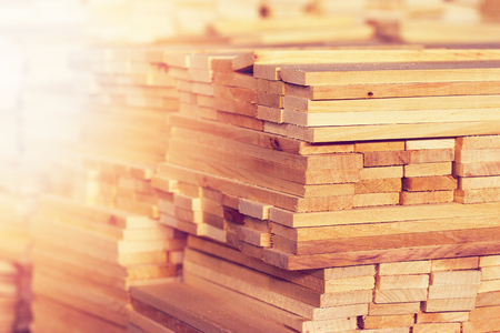 Photo pour Wood timber construction material closeup for background and texture. Stack of wooden blanks at the sawmill. - image libre de droit