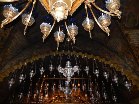 Vigil lamps, candle burning lamps, on the Golgotha in the Church of the Holy Sepulchre in Jerusalem, Israel.