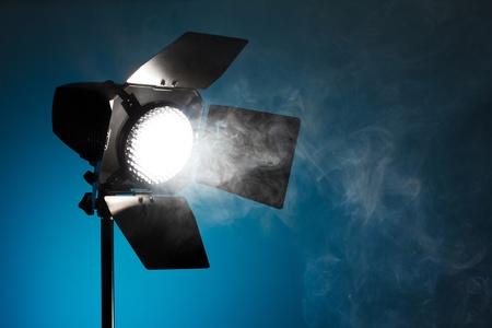 Photo pour Studio spot light with smoke - image libre de droit