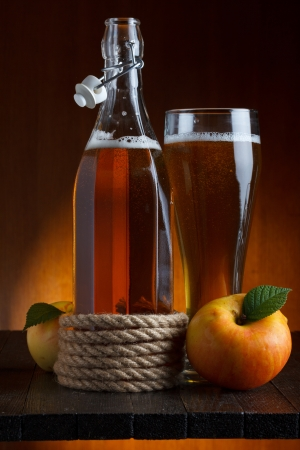 apple cider glass and bottle with apples still lifeの写真素材