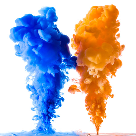Photo pour Orange and blue ink splashes in the water, isolated on white background - image libre de droit