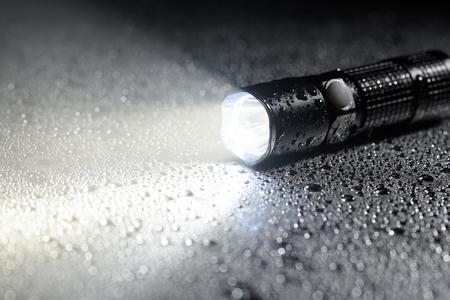 Photo pour Tactical waterproof flashlight - image libre de droit