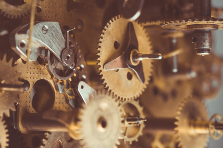 Vintage gears and cogs in mechanism macro retro toned