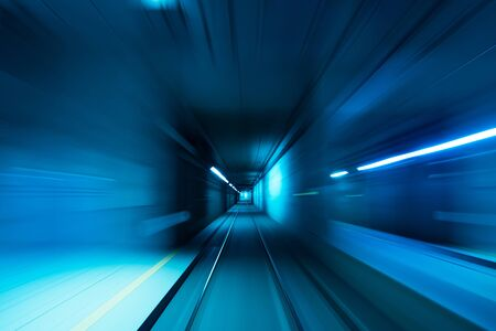 Photo pour Subway tunnel motion speed rail blue blurred lights - image libre de droit