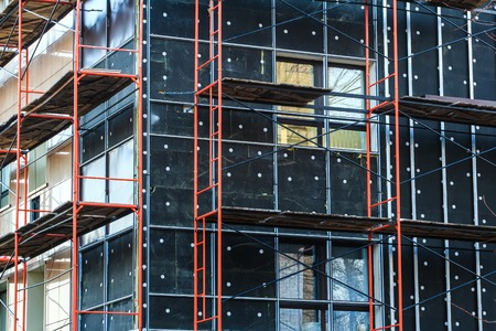 exterior insulation of building facade and walls under construction