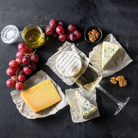 Foto für Cheese appetizer snacks french cheese, glass sauvignon wine on the blackboard square. - Lizenzfreies Bild