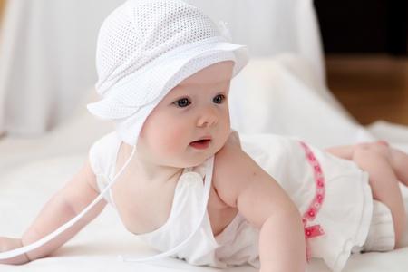 Photo pour portrait of cute little baby in a funny hat - image libre de droit