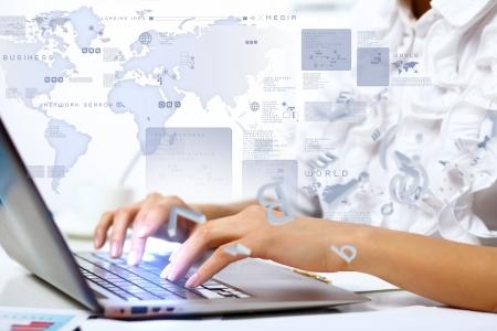 Foto de Business person working on computer against technology background - Imagen libre de derechos