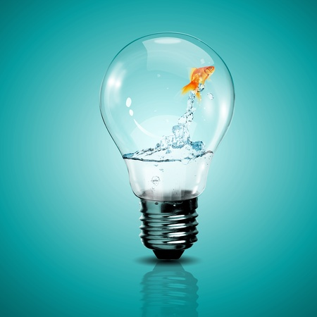 Photo for Gold fish in water inside an electric light bulb - Royalty Free Image