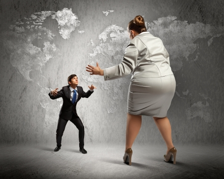 Image of businesspeople arguing and acting as sumo fighters
