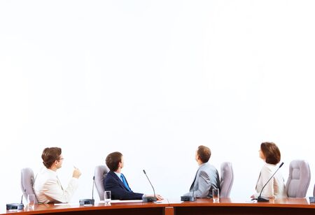 Image of businesspeople at presentation looking at screen  Space for advertisment