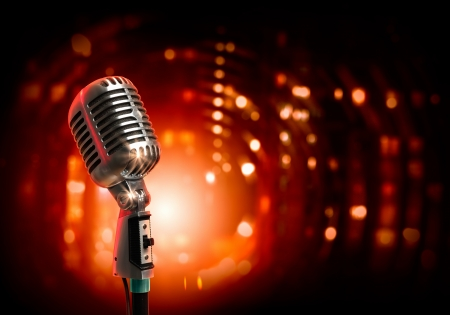 Photo pour Single retro microphone against colourful background with lights - image libre de droit