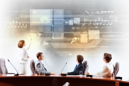 Photo for Image of businesspeople at presentation looking at virtual project - Royalty Free Image