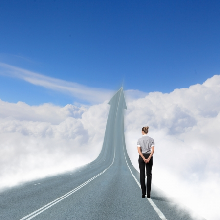 Photo pour Concept of the road to success with a businesswoman standing on the road - image libre de droit