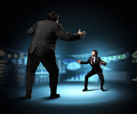 Image of businesspeople arguing and acting as sumo fighters against city background