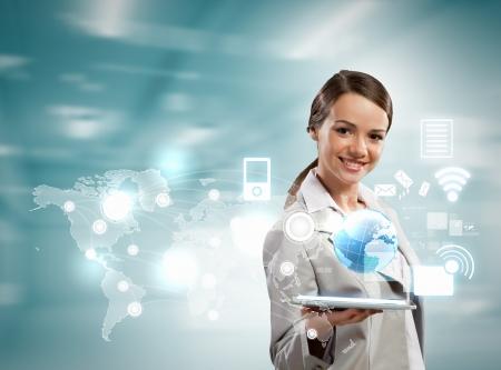 Foto de Image of businesswoman with tablet pc against high-tech background - Imagen libre de derechos